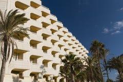 Hotel Balconies And Palm Trees, Fuerteventura. Hotel balconies and palm trees with deep blue sky in Fuerteventura, Spain Royalty Free Stock Photos