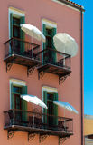 Hotel balconies with umbrellas Stock Photo