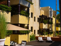 Hotel with balconies and wooden deck in a resort in Mexico Royalty Free Stock Photos