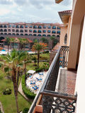 Hotel balcony and complex  at San Jose  Sea of Cortez. Hotels overlooking the Sea of Cortez. Pool  with vacationers and umbrellas. In Baja Mexico near San Jose Royalty Free Stock Photos