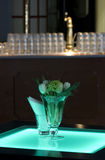 Hotel ballroom with luminous tables and a bar unit. Hotel ballroom with luminous bar tables and a bar unit setup for a fancy reception stock image
