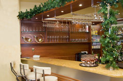 Hotel bar. Modern hotel bar with stools in front of buffet stock images