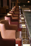 Hotel bar interior. Row of seats in small hotel bar Stock Photos