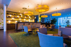Hotel bar lounge with big lights. And illumination in 50s style royalty free stock photos
