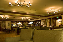 Hotel bar restaurant. This bar restaurant is big. It has very nice furniture and lighting. It is in Hilton Seattle Royalty Free Stock Image