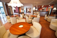 Hotel bar. A wide angle view of a modern hotel bar stock photography