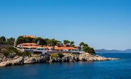 Hotel at the beach. Hotel build above the stony beach Royalty Free Stock Photo