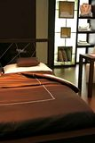 Hotel bed. Designed in brown color Royalty Free Stock Photography