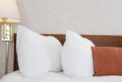 Hotel bed. Made up bed in a hotel room with night lamps Royalty Free Stock Image