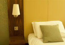 Hotel Bed and bedside lamp Royalty Free Stock Image