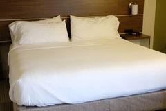 Hotel Bed. A clean hotel bed and mattress Royalty Free Stock Photos