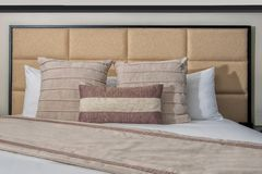 Hotel Bed, head board, pillows, comforter and white linen stock photos