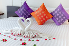 Hotel bedding with swan origami Stock Photography