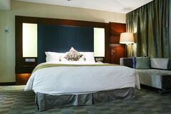 Hotel bedroom. With king size bed Royalty Free Stock Photo