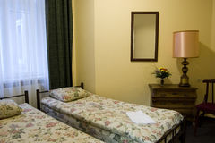 Hotel bedroom. Picture of a hotel bedroom with comfortable beds and nice decoration Royalty Free Stock Photography