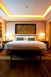 Hotel Bedroom. Luxurious hotel room with king sized bed Stock Photography