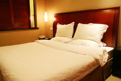 Hotel bedroom. With king size bed Royalty Free Stock Image