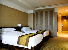 Hotel Bedroom. A comfortable, well-furnished hotel bedroom royalty free stock photography