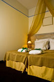 Hotel bedroom with drape Royalty Free Stock Photos