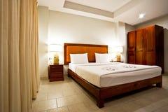 Hotel bedroom interior. In evening stock images