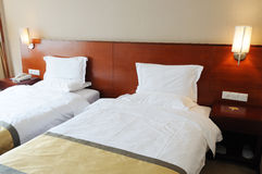 Hotel Bedroom interior. Warmly bedroom in a the hotel Stock Photography