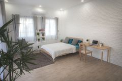 Hotel bedroom interior design. White bedroom setting studio for rent. Hotel bedroom interior design. White bedroom setting studio for rent stock photo