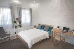 Hotel bedroom interior design. White bedroom setting studio for rent. royalty free stock image