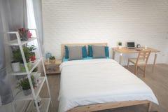 Hotel bedroom interior design. White bedroom setting studio for rent. Hotel bedroom interior design. White bedroom setting studio for rent stock image