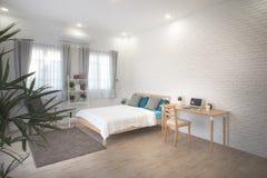 Hotel bedroom interior design. White bedroom setting studio for rent. Hotel bedroom interior design. White bedroom setting studio for rent stock images