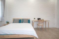 Hotel bedroom interior design. White bedroom setting studio for rent. Hotel bedroom interior design. White bedroom setting studio for rent stock photography