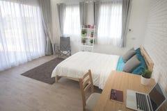 Hotel bedroom interior design. White bedroom setting studio for rent. stock photos