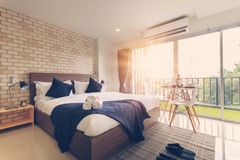 Hotel bedroom interior design. White bedroom setting studio for stock photography