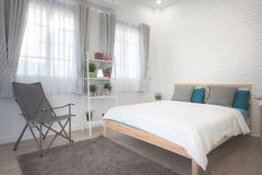 Hotel bedroom interior design. White bedroom setting studio for rent. royalty free stock photos