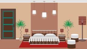 Hotel bedroom interior including light equipment, bed, houseplant Stock Photo