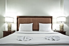 Hotel bedroom interior with pillows and lamps Royalty Free Stock Photo