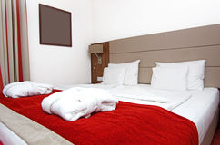 Hotel bedroom. Luxurious suite with decorated bed stock photography