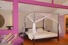 Hotel bedroom with mosquito netting Stock Photo