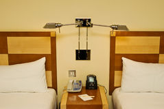 Hotel bedside. A bedside scene typical of hotels around the world stock images