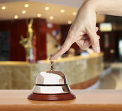 Hotel bell. Hand of a woman using a hotel bell Stock Photos