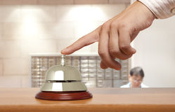 Hotel bell. Hand of a man using a hotel bell Stock Images