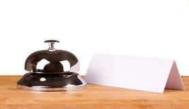 Hotel bell and blank paper Royalty Free Stock Photo