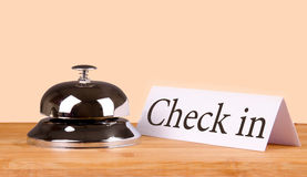 Hotel bell check in. Hotel bell at the table Royalty Free Stock Photos