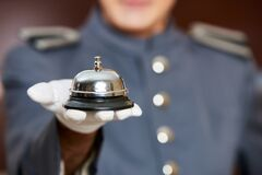 Free Hotel Bell On Hand By Concierge Stock Photos - 171024423