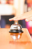 Hotel bell at reception desk Royalty Free Stock Image