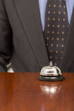Hotel bell at reception desk Stock Images