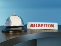 Hotel bell on the table. Reception Royalty Free Stock Photos