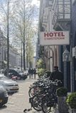 Hotel with bicycles parked in front of it in Amsterdam. A hotel with bicycles parked in front in Amsterdam, Netherlands Stock Photos