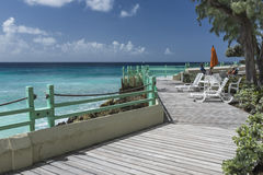Hotel boardwalk Worthing Beach Barbados. Ocean front hotel boardwalk at Worthing Beach on the south coast of the Caribbean Island of Barbados in the West Indies Royalty Free Stock Images