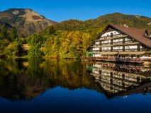 Hotel Bor and mountains in autumn colors reflecting Lake Crnava. PREDDVOR, SLOVENIA - OCTOBER 7th 2017: Hotel Bor and mountains in autumn colors reflecting Lake Stock Photo