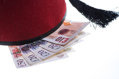 Hotel boy hat and british money isolated Stock Photography